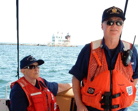 Ellie Sawyer and Tom Lambert on patrol by the Breakwater Lighthouse on the Penobscot River