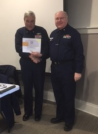Division Commander Duane Minton presenting Flotilla Commander Darrell Gilman, Flotilla 013-01-05 Penobscot Bay, with Auxiliary Operations Service Award for 42 hours as Lead Instructor.