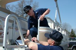 Auxiliarists conduct a vessel safety check