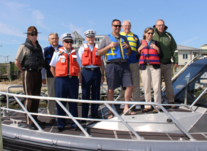 Left to right: Fish & Wildlife Natural Resources Police Chief Robert Legates, DNREC Division of Fish & Wildlife Director David Saveikis, Coast Guard Auxiliary Flotilla 12-02 FSO-MT Thomas Mann, Auxiliary Division 12 Commander Warren Huff, State Senator Ernest Lopez, State Representative Harvey Kenton, DNREC Deputy Secretary Kara Coats and State Representative Richard Collins.