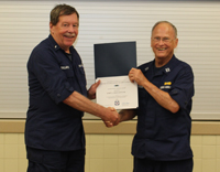 Membership Service Award was presented to John Ballantyne (l) for Ten Years of Dedicated Service as a member of the United States Coast Guard Auxiliary.    Presented by Flotilla Commander Richard Stevenson (r).