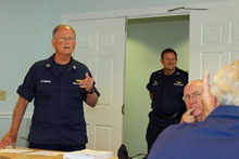 Event organizer Dick Stevenson (L) and principal instructor Don Gerhart (In doorway) with Bud Trainer listening to questions from the floor.