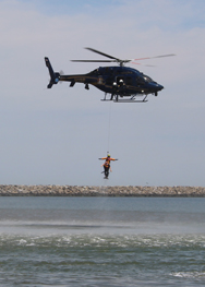 "Delaware State Police demonstrate a helicopter water rescue.  ""Oscar"" is hooked up so that the rescuer is not required to hold on to him (her) at all!"