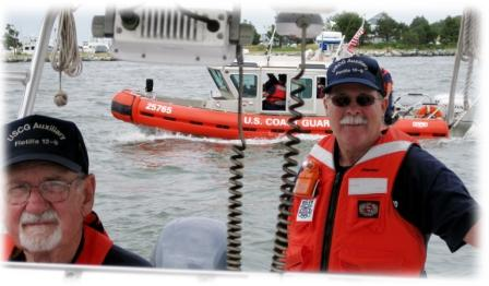 Andy Smith (L) and Denny Nield prepare for a towing excercise with the CG crew from Station Indian River, Delaware.