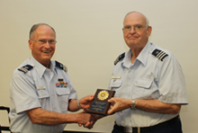Flotilla Commander Dick Stevenson presents Bill Tower (left) with the District Vessel Examination Award for 2016.