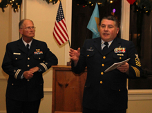 CGAux Flotilla Commander, Richard Stevenson (l) watches on as Coast Guard Station Chief, Jim Pond, (r) addresses the CG Auxiliary holiday party attendees.  The Chief routinely makes himself and his crew available for training, education and support for Auxiliarists.