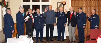 Seven USCG Flotilla 12-09 Auxiliary elected and appointed Officers for 2017 were initiated by District Commander Warren Hoff as over-seen by Coast Guard BMC Jim Pond, Chief of CG Station Indian River.   l-r: USCG BMC Jim Pond; CG Auxiliary DVDR Warren Huff;– IPFC John Umbel ; VE Bill Tower; PV Jim LaValley; VFC Roy Zimmerman; PE Andy Smith; CS John Ballantyne; FC Richard Stevenson.