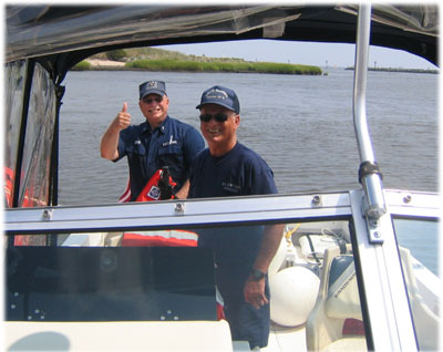 Coast Guard Auxiliarists enjoynig patrol on the Delaware Bay.