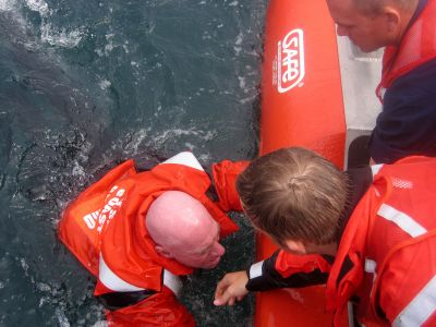 Coast Guard Auxilarists performing a simulated rescue.
