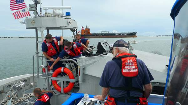Auxiliary and Coast Guard working together at sea