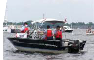 Image of single boat with three Auxiliarists on board