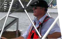 Image of coxswain piloting Auxiliary boat