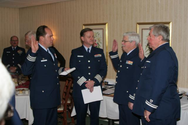 Division Commander Robert Sersen and District Captain Mike Weiss swear in Paul Morin and Bruce Rowley