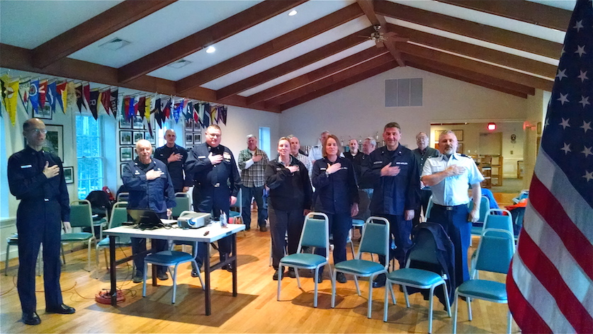 Members of U S Coast Guard Auxiliary Flotilla 2 5 0 8 reciting the Pledge of Allegiance