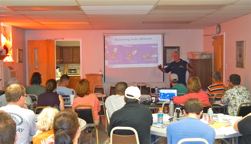 An instructor with U S Coast Guard Auxiliary Flotilla 25 O 8 teaching boat handling during an About Boating Safety class