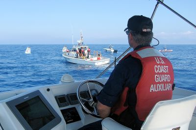 Picture of Auxiliary boat approaching USCG 41UTB responding at the scene of a plane crash into the ocean.