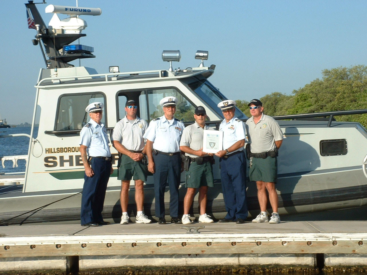 Presenting the Hillsborough County Sheriffs Patrol with a 60th Anniversary Vessel Inspection Plaque