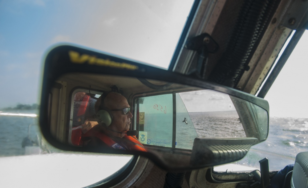 Image of Coast Guard Auxiliary member in mirror
