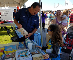 Coast Guard Auxiliary Member interacting with the public