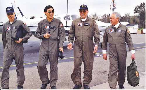 4 guys walking in flight suits