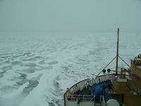 Bow of a large Coast Guard Vessel breaking ice in a large lake