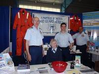 Three people in Coast Guard Auxiliary Uniforms at a Public Information Booth