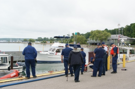Several Members of the Coast Guard and the Coast Guard Auxiliary on the Dock at Station Charlevoix,  There are several Coast Guard and Coast Auxiliary Patrol Boast are in foreground