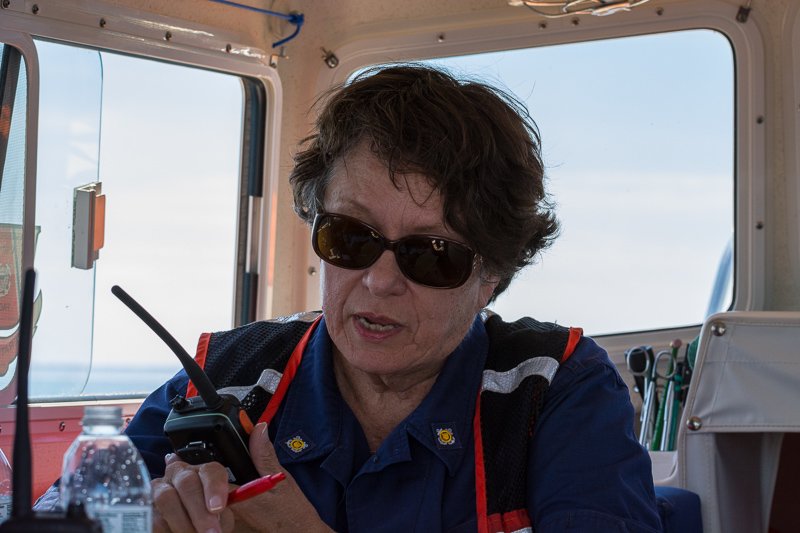 Kathy communicating with aircraft during search while on board a Flotilla Facility