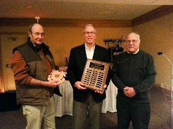 Randy Lawton receives the Carl Luhr award from Leo Fix and John Weih