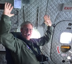 Mike enjoying the take off while riding near the cargo door of the C-144