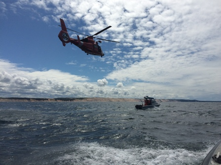 USCG Helicopter Conducting a hoist from Aux Vessel Results
