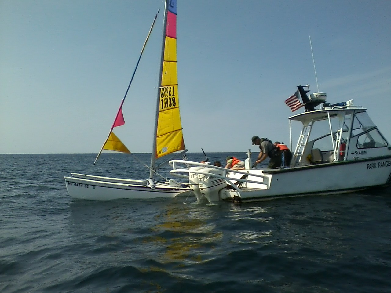 Righted sailboat with NPS SeaArk Vessel