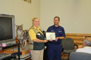 Certificate of Appreciation being presented to Gander Mountain
