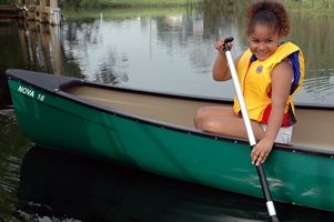kid in canoe