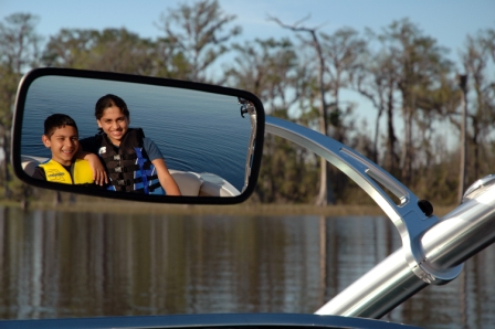 Boy and Girl in rear view mirror