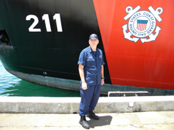 Brian McArdle in front of USCG Cutter Oak.